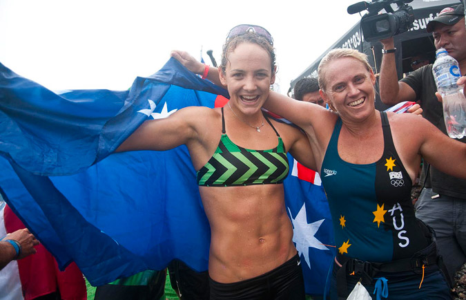 Australia's Jordan Mercer and Angela Jackson celebrate after winning the Women's Paddleboard Race and SUP Race respectively. Photo: ISA/Rommel