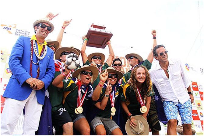 The defending Champions from the inaugural 2012 ISA World SUP and Paddleboard Championship, Team Australia, shown here with ISA President Fernando Aguerre (far left) and Club Waikiki President Jose Osterling (far right) as they lift the Club Waikiki-Peru Team Trophy, will be back this year in full force featuring the defending Champions Jamie Mitchell, Brad Gaul, and Jordan Mercer. Photo: ISA/Marotta