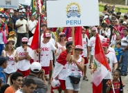 Team Peru at the Parade Of Nations. Credit: ISA/Michael Tweddle