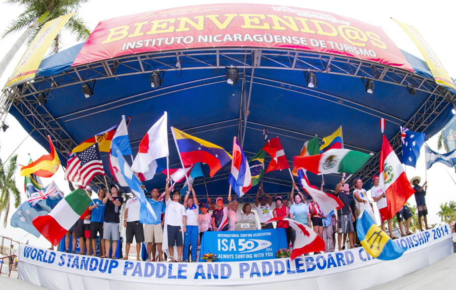 ISA Vice President Alan Atkins and Ministry of Tourism Mayra Salinas amongst the flags of the 27 National Teams, officially declared open the 2014 ISA World SUP and Paddleboard Championship. Photo: ISA/Michael Tweddle