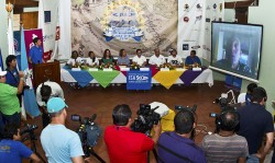 ISA President Fernando Aguerre (on screen) was joined by Nicaragua's Minister of Tourism Mayra Salinas (fourth from right), Local Event Organizer Lucy Valenti (third from left), Mayor of Granada Julia Mena (fourth from left), Mayor of Diriamba (third from right), Nicaragua Team Manager Ronaldo Urroz (far right), Nicaragua Team Members Norwin Estrella and Ana Urroz (far left) and ISA Gold Medalist Casper Steinfath (second from right) at the official press conference. Photo: ISA/Michael Tweddle
