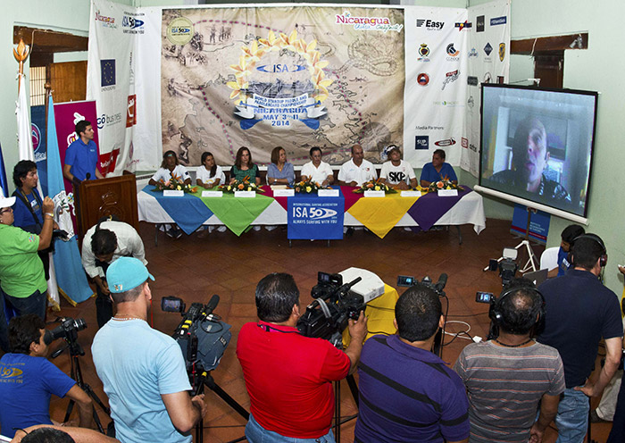 ISA President Fernando Aguerre (on screen) was joined by Nicaragua's Minister of Tourism Mayra Salinas (fourth from right), Local Event Organizer Lucy Valenti (third from left), Nicaragua Team Manager Ronaldo Urroz (far right), Nicaragua Team Members Norwin Estrella and Ana Urroz (far left) and ISA Gold Medalist Casper Steinfath (second from right) at the official press conference. Photo: ISA/Michael Tweddle